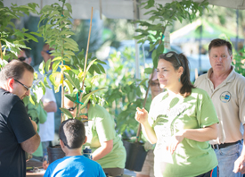 Resident and volunteers with trees