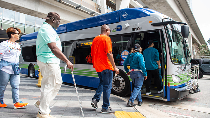People boarding a Miami-Dade County bus